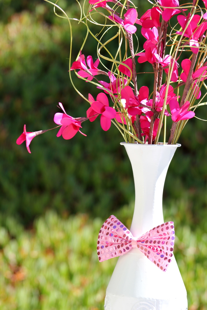 girly circus flower centerpiece with sequin bow