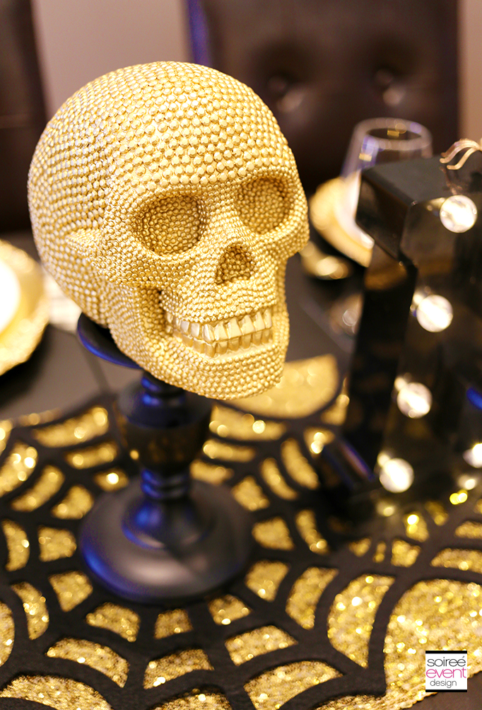 Gold skull candlestick