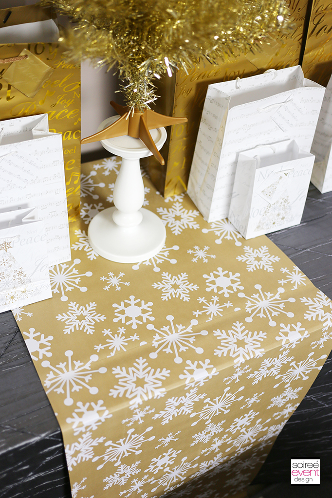 gold and white snowflake table runner