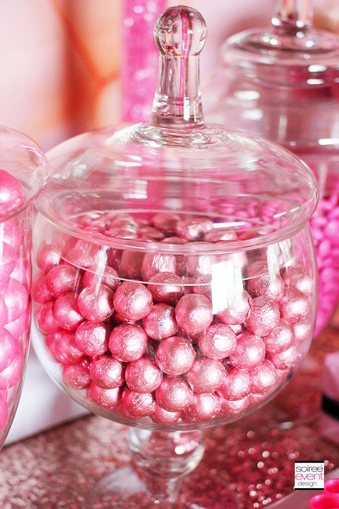 Pink bulk candy in apothecary jars