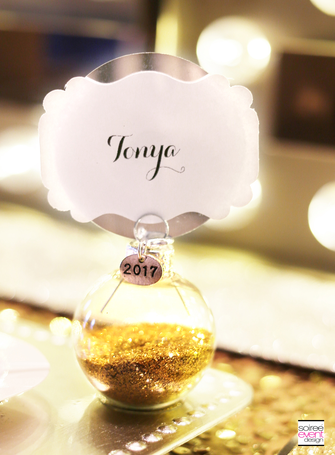 to make custom diy place cards for each guest at the dining table how sparkly and fabulous are these guests can take these home as well